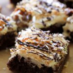 Samoa Brownies from chef-in-training.com ...Rich fudgey brownies toped with a delicious salted caramel buttercream, toasted coconut, chocolate and gooey caramel.