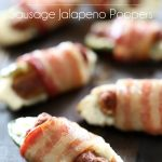 Bacon-Wrapped Sausage Jalapeño Poppers... The perfect appetizer for game day! Packed with heat, cool cream cheese and sizzling flavor!