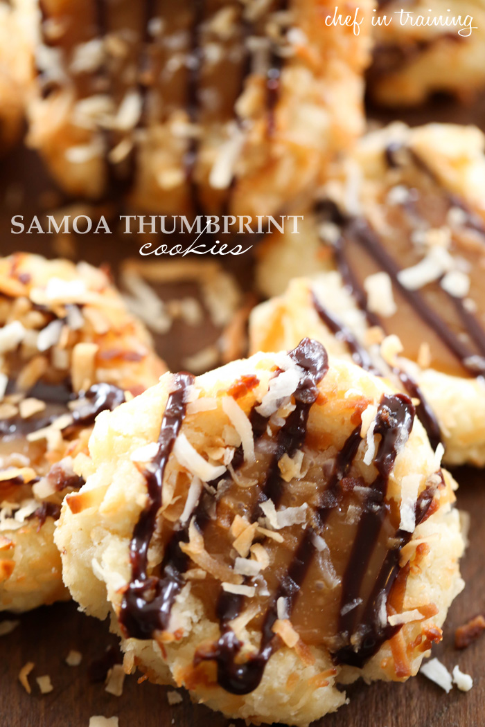 Samoa Thumbprint Cookies... Soft shortbread cookies filled with a gooey caramel and coated in delicious toasted coconut and chocolate drizzle! These are such a fun spin on the classic girl scout cookies!