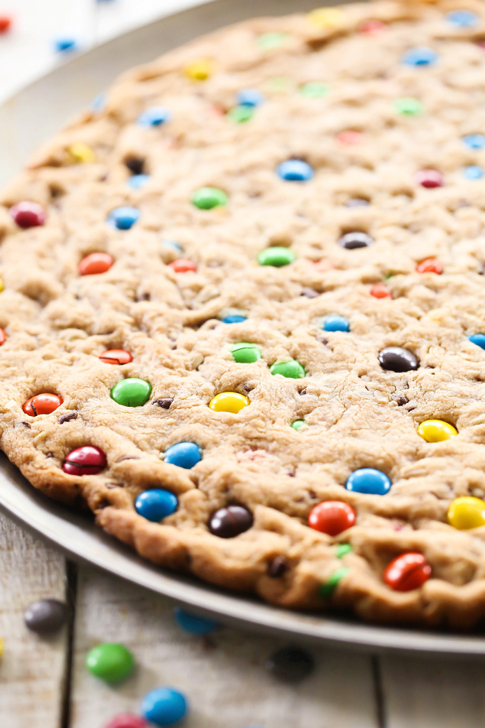 This M&M'S Monster Cookie Pizza is the ultimate dessert! It is layer upon layer of heaven! Everyone will be raving about this recipe! #BetterWithMMS @M&M'S Chocolate