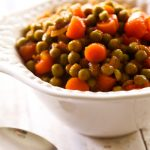 Saucy Peas and Carrots... this recipe is super flavorful and a great way to change up your traditional side dish!