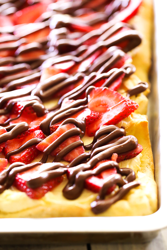 Strawberry Nutella Eclair Cake... this recipe is AMAZING and perfect for summer! The flavor and ingredient combo is divine!