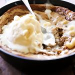 This Blondie Skillet Cookie is a DELICIOUS Melt-in-your-mouth recipe! The Cream Cheese Drizzle is the perfect finishing touch!