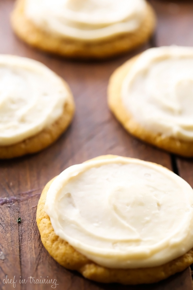 Soft Pumpkin Sugar Cookies with Caramel Cream Cheese Frosting... These will be some of THE BEST pumpkin cookies you ever try! The frosting on top is out of this world and the perfect compliment to these delicious cookies!