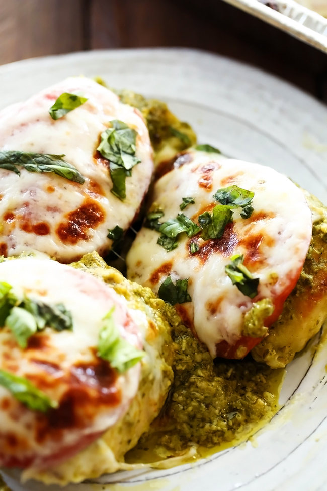 Pesto Chicken... This chicken is packed with flavor and super easy to make! With delicious pesto, melty cheese and tasty tomatoes, this is sure to be a hit at the dinner table!