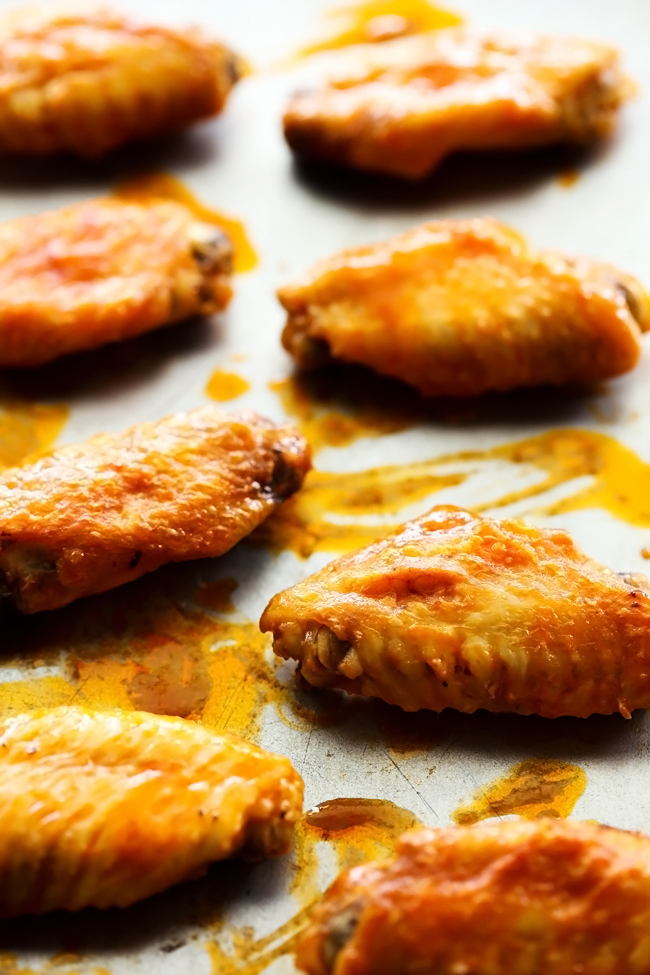 Buffalo Chicken Wings... A delicious appetizer that is perfectly flavored! It has just the right amount of heat and is a huge crowd pleaser!