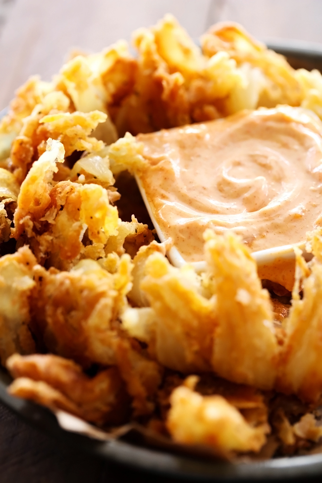 Blooming Onion with Dipping Sauce... This is such an incredible appetizer. The flavor of the battered onion combined with the sauce makes for one addictive and unforgettable recipe!