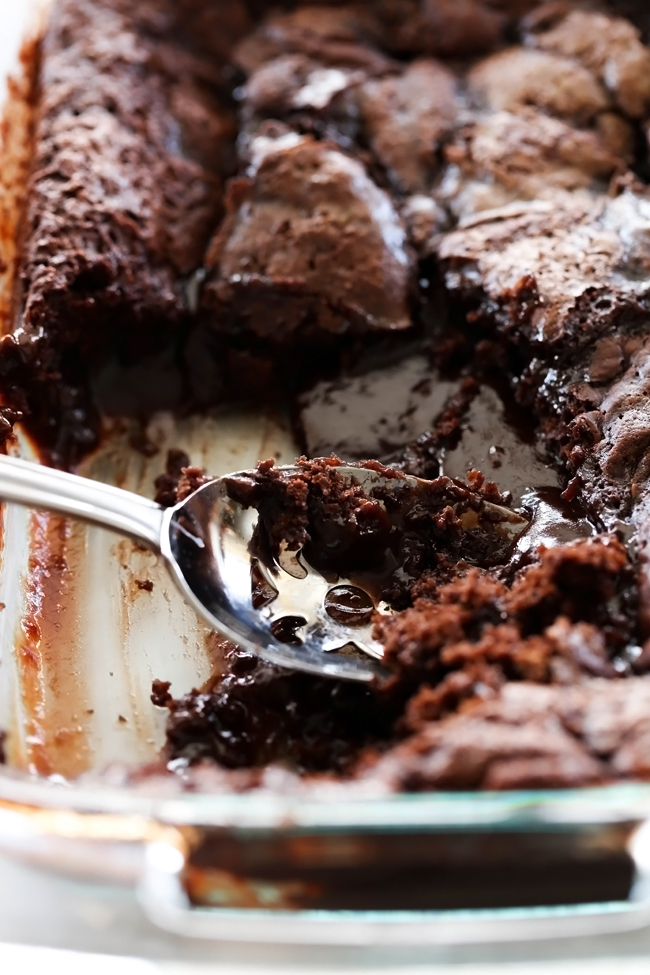 Hot Fudge Pudding Cake... A rich delicious cake that is magically develops a hot fudge base at the bottom and is spooned into a bowl for one delectable and gorgeous chocolate flowing cake.