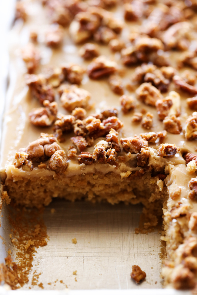 Praline Sheet Cake... A moist and delicious brown sugar sheet cake with an amazing caramel frosting. The sheet cake is topped wight he most delicious sweet and crunchy pralines for a perfect bite each and every time!