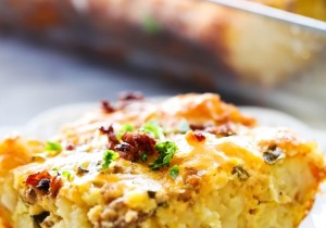 Tater Tot Breakfast Casserole... All of your favorite breakfast items combine to make one out of this world meal! Tater tots, eggs, sausage and cheese come together in a unique way for an easy and delicious breakfast!