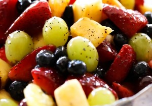 Best Ever Fruit Salad... A delicious fruit salad that has an incredible poppy seed apricot glaze! This would be a hit at any gathering!