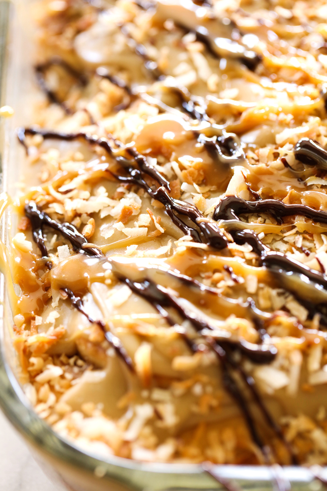 Samoa Sweet Rolls... These sweet rolls are made with a super simple cake-mix dough and have a delicious brown sugar toasted coconut filling and mini chocolate chips. They are topped with THE BEST caramel frosting, garnished with toasted coconut and drizzled with caramel and chocolate. They are unbelievably good!