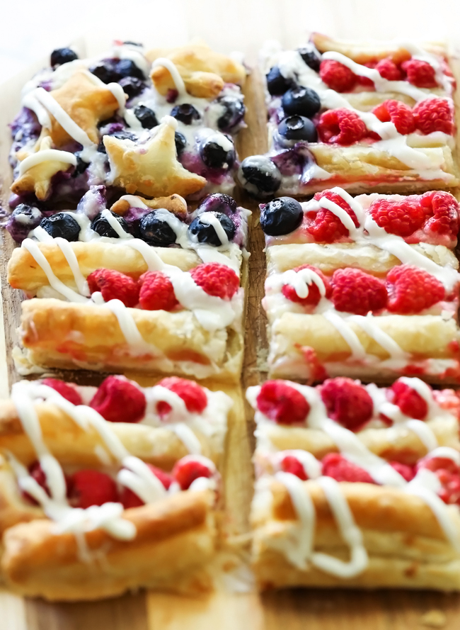 Patriotic Danish Pastry Dessert... not only does this resemble a festive flag, but will be one of the tastiest treats you ever make! The cream layer paired with the buttery puff pastry and fresh fruit combine for one heavenly dessert!