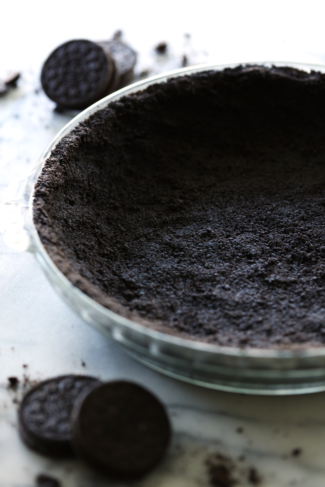 No Bake Oreo Pie Crust... A simple and delicious pie crust recipe that is perfect for no bake pies! It pairs well with with anything that goes with chocolate!