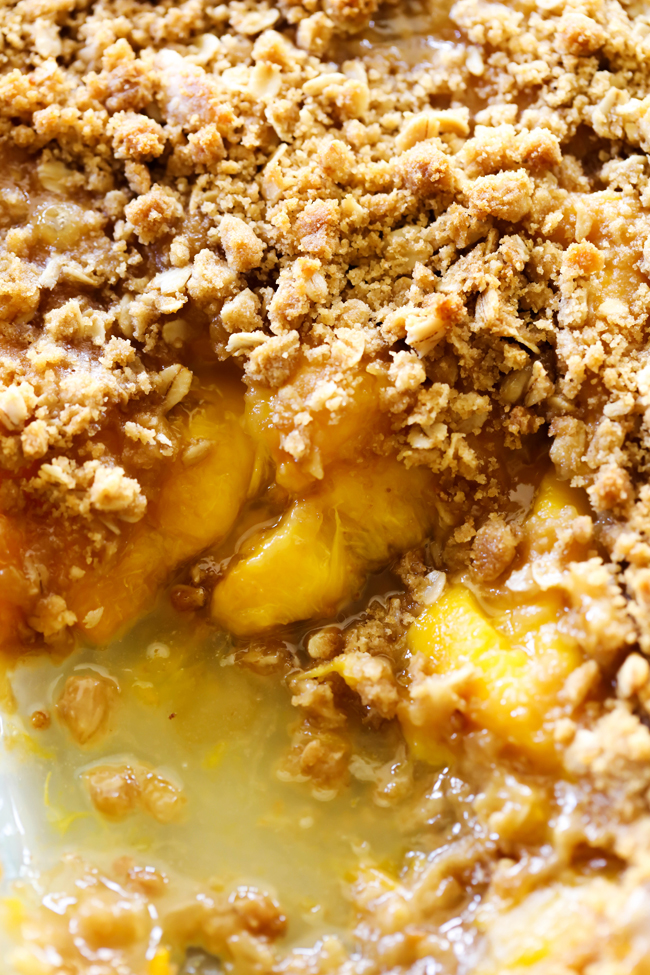 This Easy Homemade Peach Crisp is super simple and it tastes amazing! That crumb topping paired with the juicy peaches is a match made in heaven!