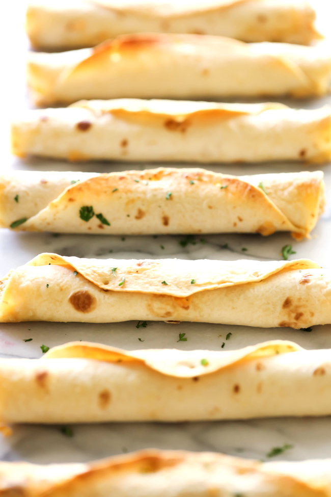 These Baked Creamy Chile Verde Chicken Taquitos are so easy to make and are beyond delicious! This will quickly become a new family favorite!
