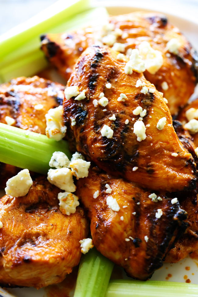 This Grilled Buffalo Chicken begins with a delicious buffalo sauce marinade that is packed with a kick! This is such a fun and tasty grill recipe!