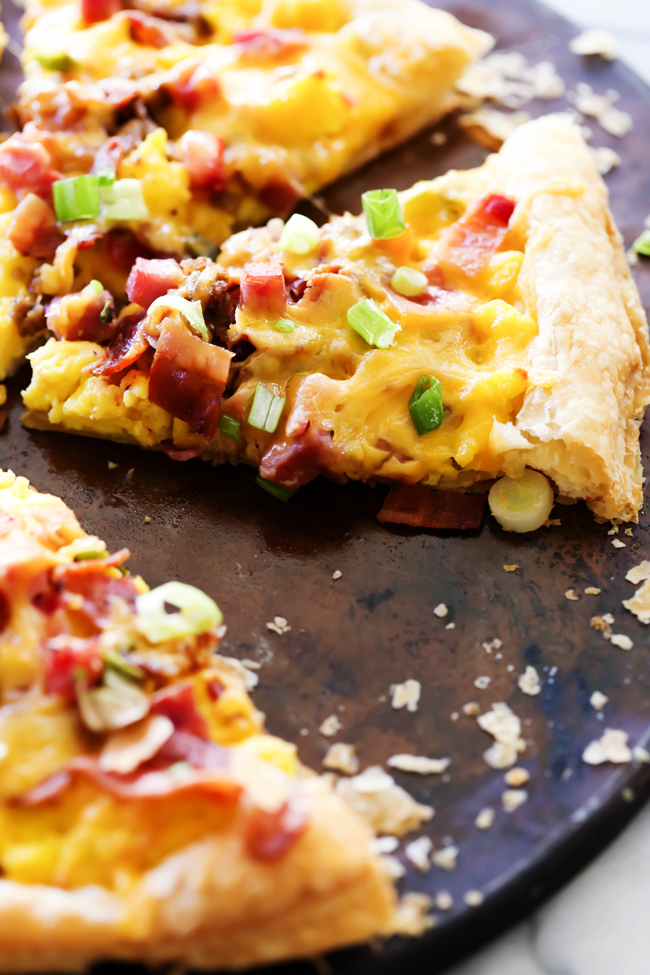 This Puff Pastry Breakfast Pizza is SO easy to make and is such a crowd pleaser! It has everything you love about breakfast topped on a delicious buttery flaky crust!