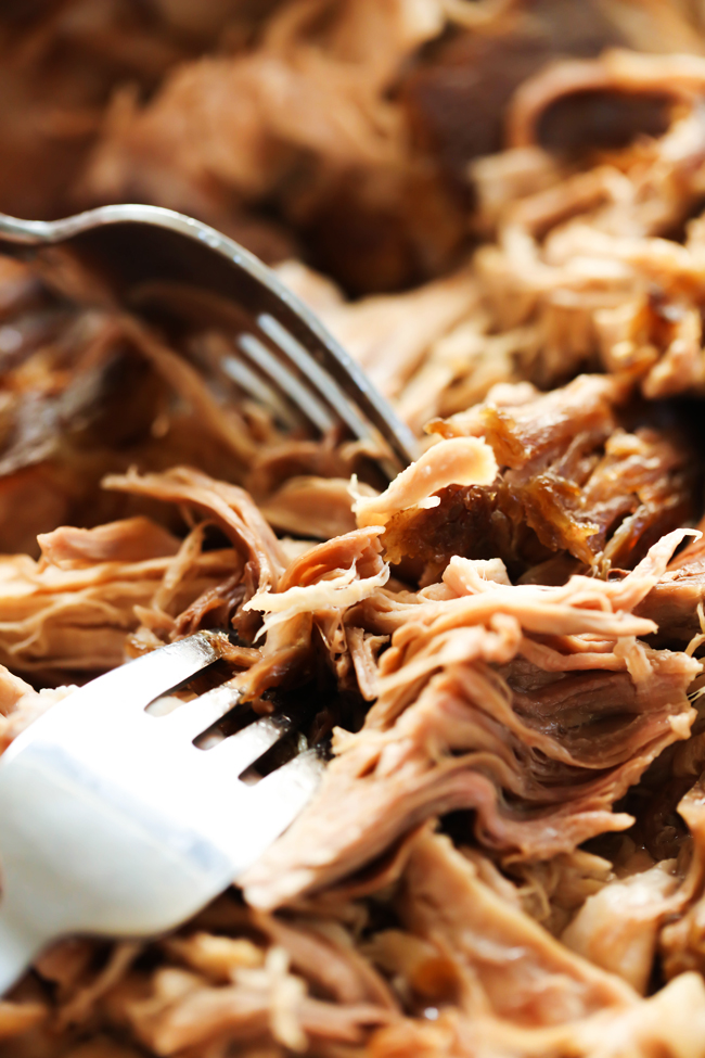 This Slow Cooker Kalua Pulled Pork is a flavorful and fantastic dinner! It cooks to perfection all day in the slow cooker until it is tender, juicy and absolutely delicious!
