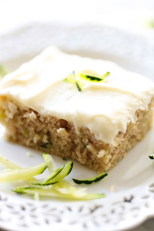 This Zucchini Sheet Cake is so moist and delicious! It feeds a crowd and is the perfect way to use up some zucchini. The cream cheese frosting on top is fabulous!