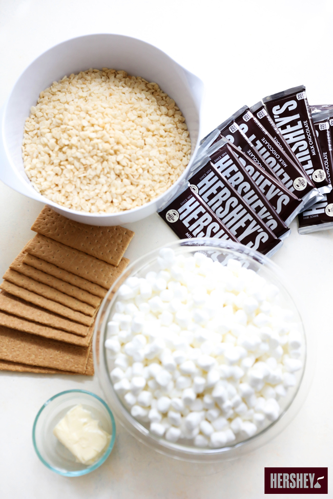These HERSHEY'S Crispy S'more Treats are out of this world! The proportions of HERSHEY'S Chocolate Bar, gooey marshmallow and graham crackers are perfection. This is a simple dessert that is great for any occasion. sponsored by HERSHEY