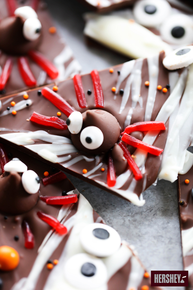 This HERSHEY'S Halloween Spider Bark is a must make this Halloween Holiday. This is a recipe the whole family will enjoy creating and eating together. It is perfect for parties and gifts and is as cute as it is delicious! sponsored by HERSHEY'S
