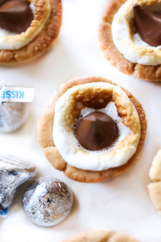 These HERSHEY'S KISSES Peanut Butter Marshmallow Cookie Cups are delightful! They have a crisp and chewy peanut butter cookie outside and are filled with HERSHEY'S KISSES Chocolates and gooey marshmallows. Each bite is absolutely heavenly! #sponsored HERSHEY'S Chocolate