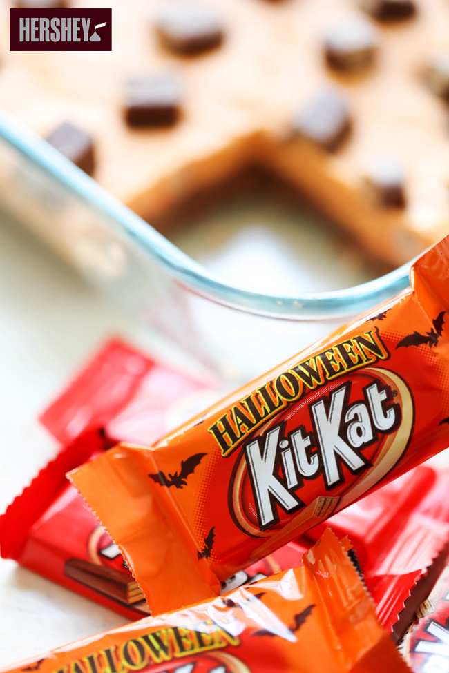 This KIT KAT® Halloween Fudge is such a fun and festive treat for the holiday. With its Halloween colors and delicious KIT KAT® Candy Bars layered both in and on top, it is sure to be a huge hit! #sponsored HERSHEY
