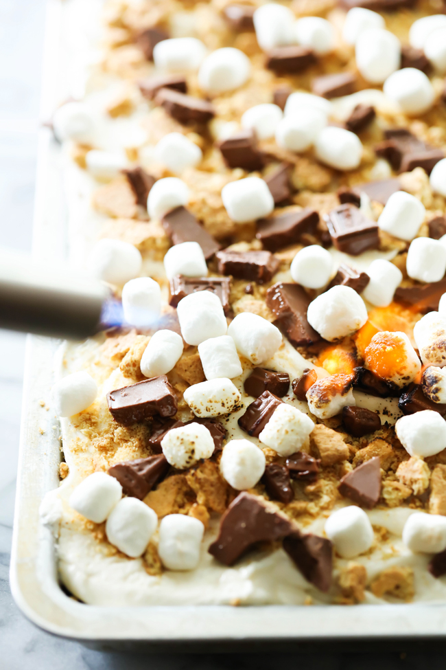 This S'more Sheet Cake is incredible! The summer flavors of chocolate, graham cracker and toasted marshmallow can be had any time of year with this moist and delicious sheet cake! This is definitely one you will want to make time and time again!