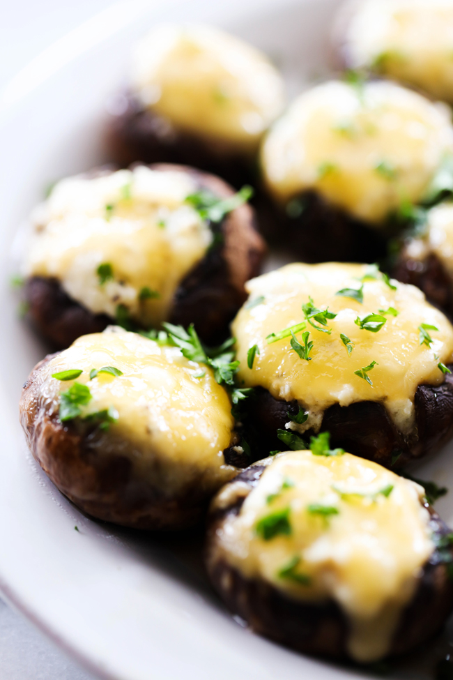 These 5 Cheese Stuffed Mushrooms are packed with bold flavor and a variety of cheese. These are the perfect appetizer to serve a crowd! Everyone LOVES these!