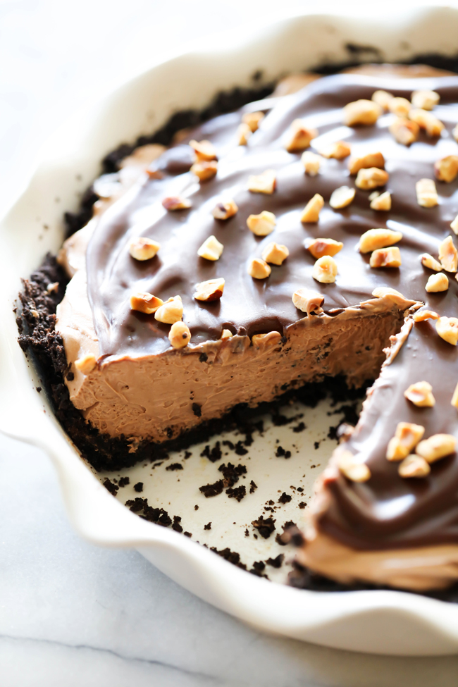 This Chocolate Hazelnut Cream Pie is rich, creamy and perfect for fulfilling that chocolate craving! It begins with a homemade Oreo crust, has a creamy chocolate hazelnut center, a rich and smooth chocolate topping and is garnished with toasted hazelnuts.