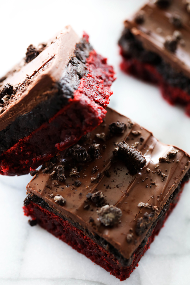 These Red Velvet Oreo Truffle Brownies are fantastic! Fudgy red velvet brownies, delicious Oreo truffle and melted chocolate combine to make the three layers of this spectacular dessert. They are a hit with everyone who try them!