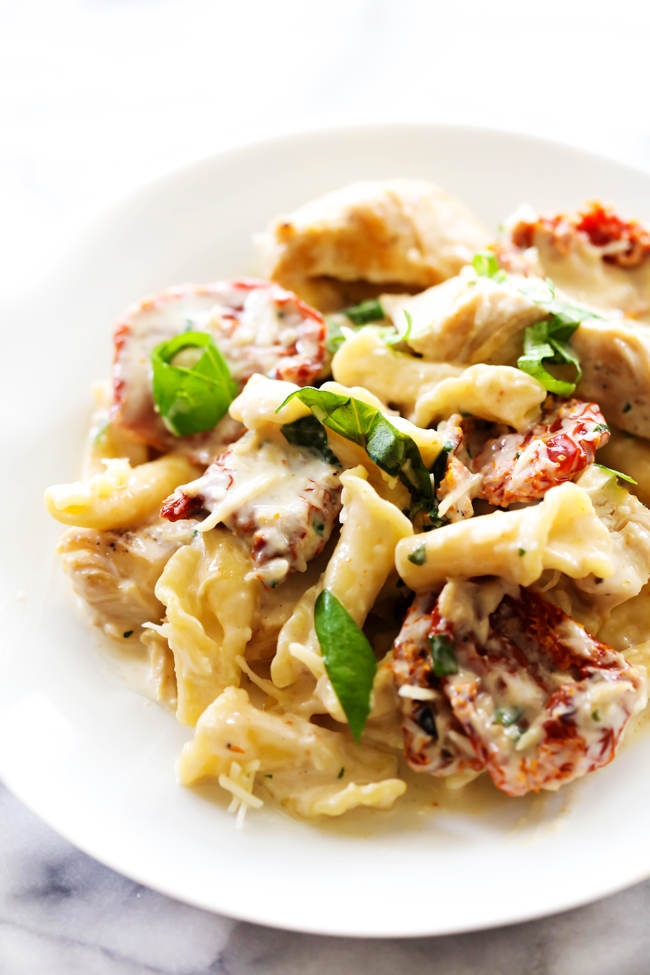 This Creamy Sun Dried Tomato Basil Pasta is a quick, easy and tasty meal that the whole family will love! With creamy alfredo sauce, sun dried tomatoes loaded with flavor and accented by sweet basil, this will become a new dinner regular at your house.