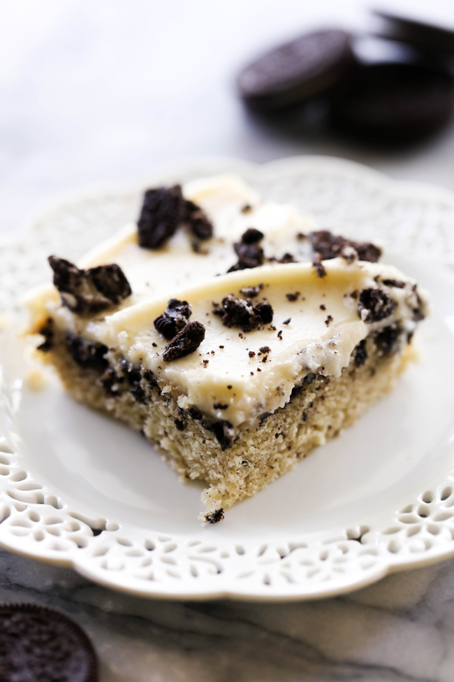 This Cookies and Cream Sheet Cake is super moist and absolutely delicious! It is perfect for parties and get togethers. It is loaded with Oreo Cookies and topped with a delicious creamy frosting.