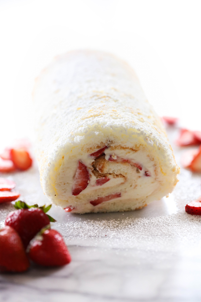 This Strawberry Shortcake Cream Roll is light, refreshing and the perfect treat to indulge in! It begins with an angel food cake that is filled with cream and strawberries. This will be the hit of any gathering!