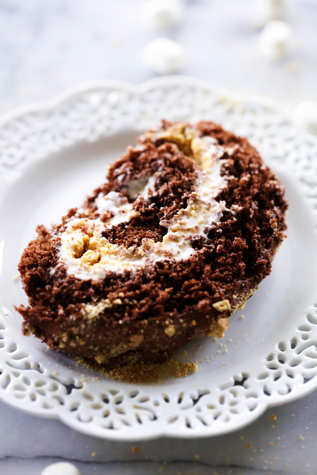 This S'more Cake Roll is outstanding! It begins with a delicious moist chocolate cake and is filled with a wonderful marshmallow cream filling and topped with graham cracker crumbs. This is sure to be a show stopper wherever it goes!