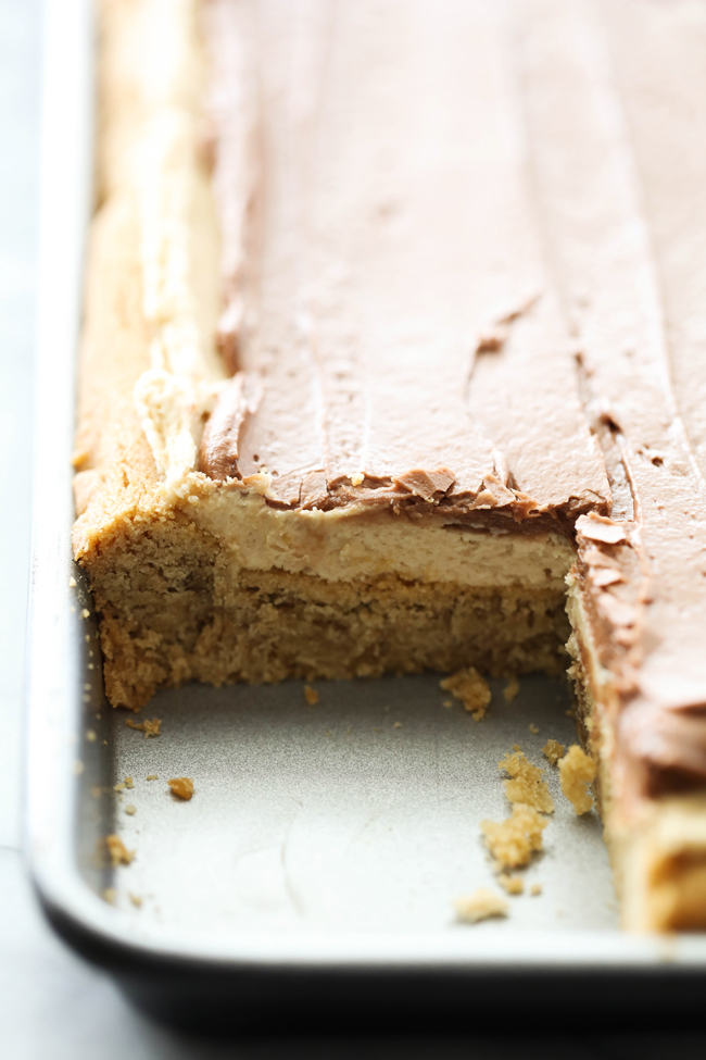 These DELICIOUS Chocolate Peanut Butter Cookie Bars have three incredible layers. It begins with a soft peanut butter cookie base and is frosted with both a layer of peanut butter buttercream and chocolate buttercream frostings. These are sure to be a huge hit with all who try them!