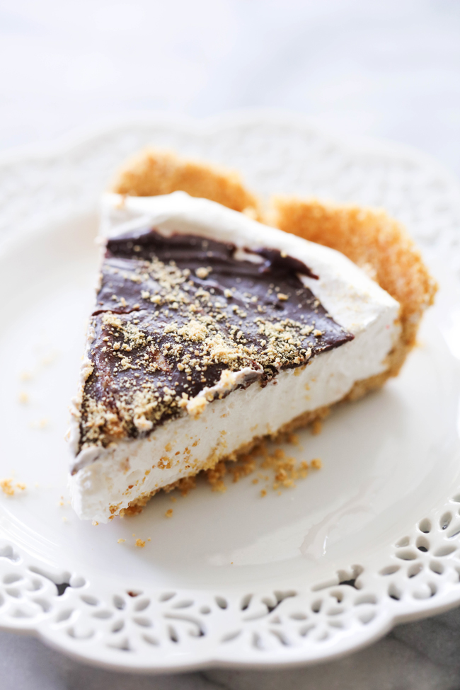 This S'more Pie begins with a delicious homemade graham cracker crust. It is filled with a divine marshmallow cream filling and topped with a rich chocolate ganache. This is such a fun and unique way to enjoy all the wonderful flavor of s'mores without having to leave your house!