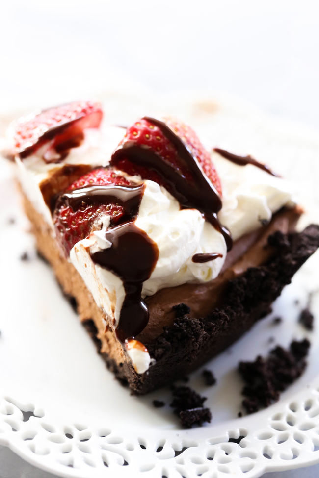 This Chocolate Strawberry Silk Pie is so silky smooth and has such a bold and rich flavor. If you are a chocolate connoisseur, this is the pie for you! It begins with an Oreo Cookie Pie Crust, filled with the delicious silky chocolatey filling and topped with delightful sweetened whip cream and gorgeous strawberries.
