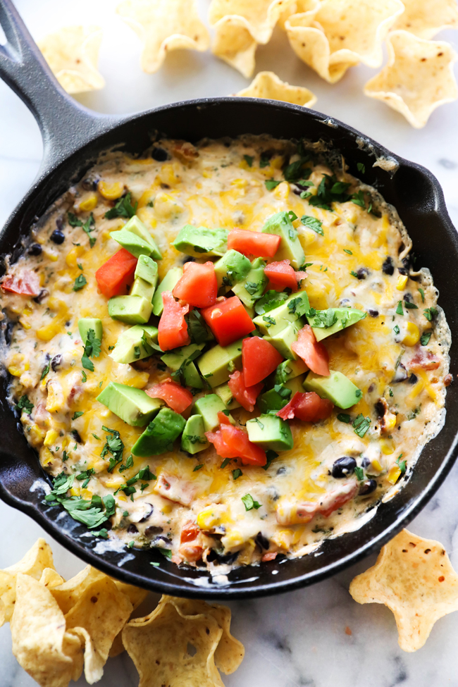 This Creamy Southwest dip is loaded with flavor and delicious ingredients. It a great appetizer for serving a crowd and will be a hit at any party!