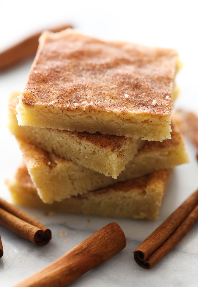 These Snickerdoodle Cookie Bars are outstanding. No more rolling each ball of dough individually- this recipe turns a time consuming recipe into an easy, quick method. Enjoy the delicious snickerdoodles in bar form. A delicious blend of cinnamon-sugar coat the top of the moist and soft cookie bars. This will be a recipe you want to make over and over again!