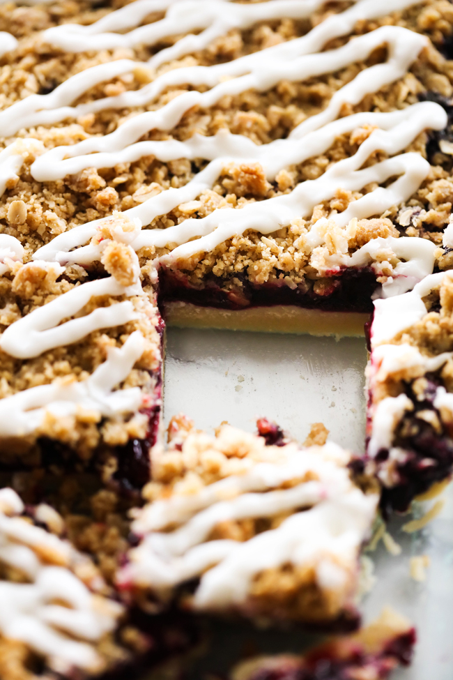 These Blueberry Cookie Crumble Bars are comprised of a shortbread cookie crust, a delicious blueberry filling, an excellent crumble over the top and are then drizzled with a creamy almond glaze. These are sure to be a hit anywhere they go!