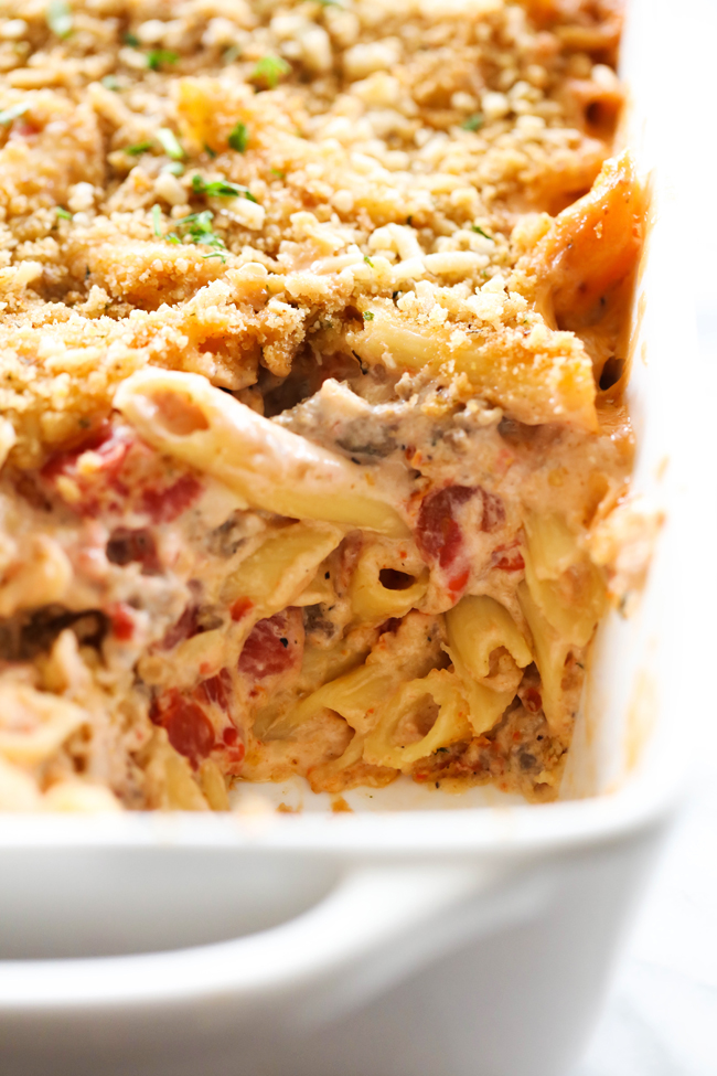 This Creamy Italian Pasta Casserole is rich, flavorful and absolutely delicious! It is comprised of the most flavorful creamy Italian sauce, sausage and cheese. This is one crowd pleasing meal that is sure to become a new regular in your home!