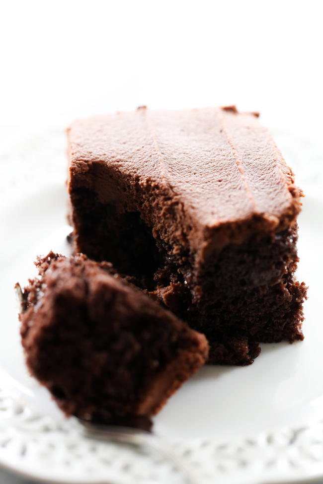 This Rich Dense Chocolate Poke Cake is a chocolate lover's dream come true! With gooey chocolate goodness infused into each bite of a chocolate cake and topped with a frosting that tastes like brownie batter it is truly a chocolate heaven! If you love chocolate, this is the cake for you!