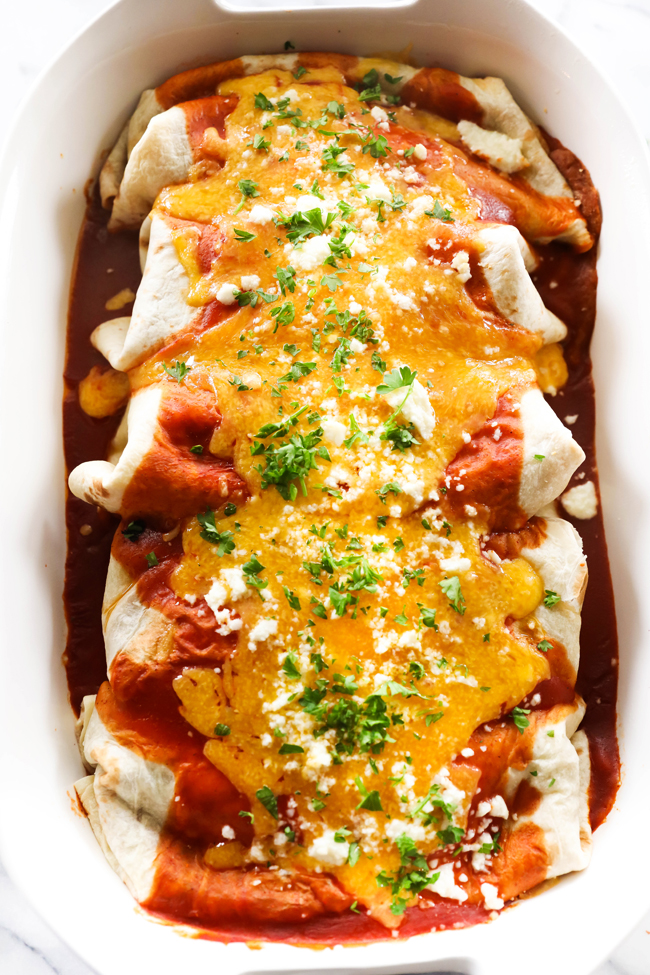 These Smothered Bean and Cheese Burritos are such a great dinner and a family favorite! The homemade refried beans take this recipe to a whole new level. The burritos are topped with a sensational homemade enchilada sauce. It is a jazzed up basic recipe that will become a new staple.