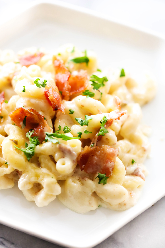 This Garlic Pepper Jack Mac and Cheese takes a classic favorite and spins it with a light kick of flavor and heat. This recipe makes for a wonderful side dish or meal all unto itself. It is topped with bacon for an added enjoyable ingredient. This is sure to become a new staple in your home!