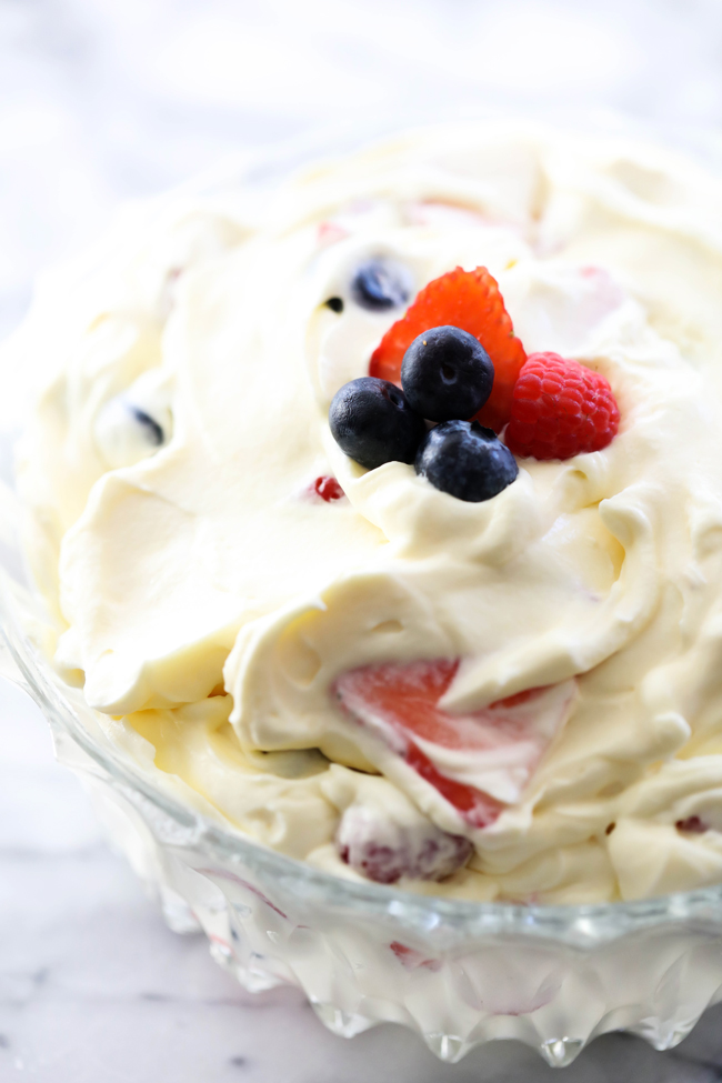 This Creamy Berry Salad is absolutely perfect for BBQs, potlucks or get togethers. It is so light in texture, and the creamy vanilla whipped filling complements the plump and juicy berries creating a refreshing and flavorful taste. This is always the first thing to disappear in a crowd.
