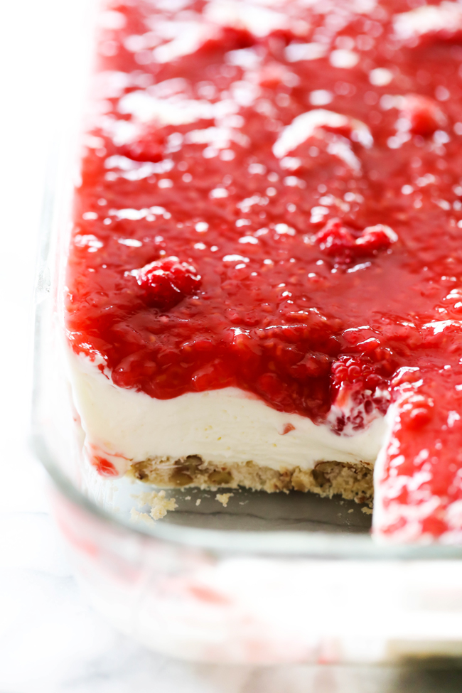 This Raspberry Cream Dessert has three incredibly delicious layers that each bring an exciting aspect to the recipe. The crust provides a wonderful texture to the other softer layers. The filling is light, sweet and soft. The most incredible part of the recipe is the third and final layer, the sweet and tart raspberry sauce. This dessert will become an instant favorite!