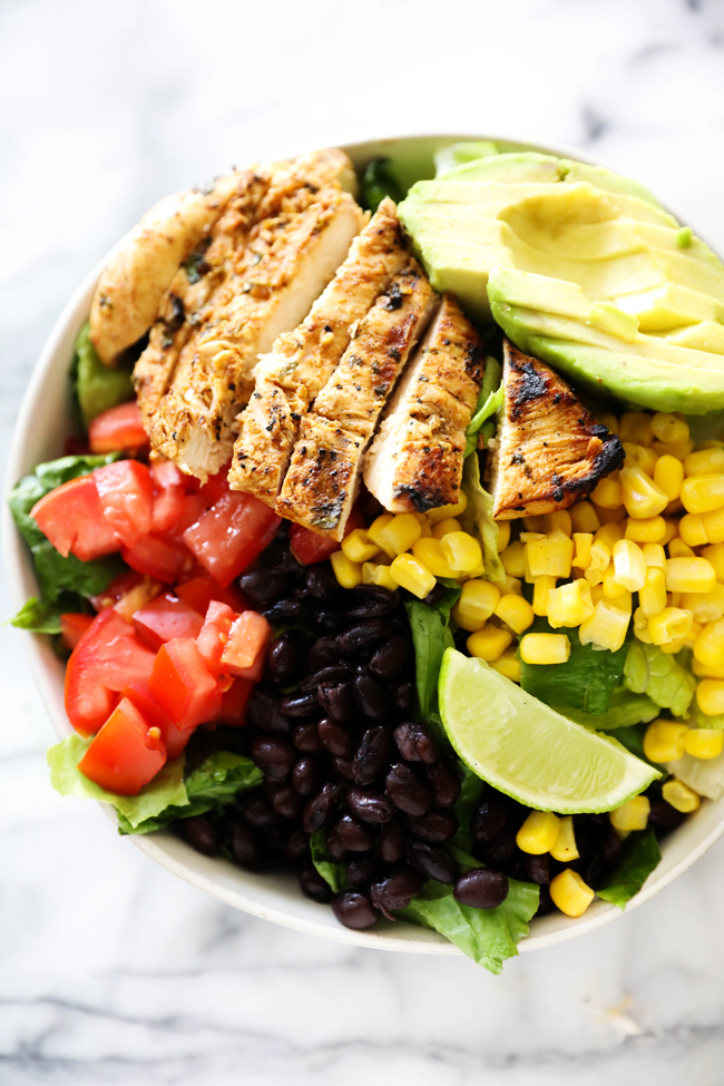 Overhead view of Southwest Chicken Salad with ingredients divided out into sections in a white bowl.