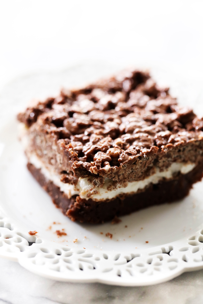Serving of Crispy Marshmallow Brownies on a white plate.
